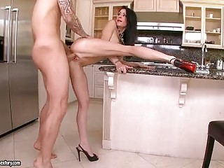 Tattoed bald stud fucking hot ass busty brunette in kitchen