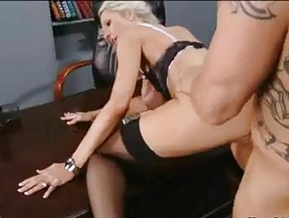 Bald hunk with tattoos nailing busy blonde in stockings in office