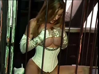 Naughty Blonde Sex Slave Venus Masturbates With a Sex Toy In a Cage