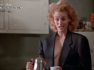 Blonde Babe Virginia Madsen Drinking Coffee and Showing Her Cleavage