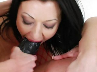 Sizzling Isabella Clark drools on this hard dildo