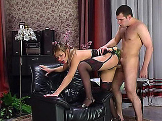 Maid in designer nylons and a lacy corset luring her taskmaster into a fuck