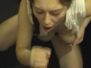 Slutty brunette bitch squats down with a cock in her face and she doesn't really even want to suck it. She jerks it off and patiently waits with her open mouth to taste the sweetness of cum.
