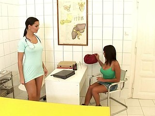 Eve examines Shanis' pussy