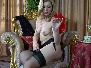 Blond temptress peels off her red negligee and puts on stylish black nylons