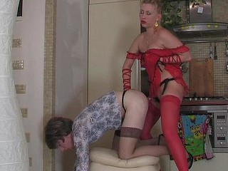 Hottie armed with strap-on working sissy guy