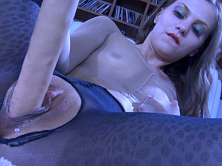 Clad in hose from top to toe playgirl sucks and stuffs her large rubber dong