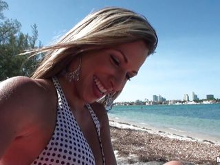 Patty is a gorgeous Latina that speaks very little English, at the beach with her boyfriend who speaks very little Spanish. She can't get him in the water, so she comes to the beach to oil up for a tan. She asks his help, and of course all he wants to rub is her ass.