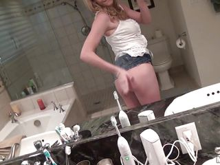 Blonde slut is filming her big ass in the mirror. Her breasts are being played with. While she prepares to give him a blowjob, her playful nipples want to be free from her bra. Will she deepthroat on his dick?