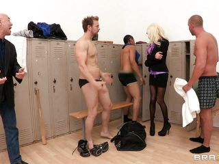 This horny blonde milf was in a men's locker room, alone, seducing a muscular guy! Looking at her amazing cleavage, the guy took out his dick and let the milf have some fun! The milf took the dick in her deep throat. Soon the guy took out the big boobs of the blonde and had a tit-fuck. Also he gave some fingering while kissing her puffy lips. After some of these playing the milf went back on sucking the dick!