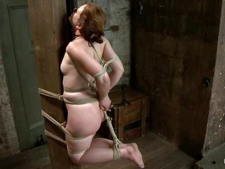 Sarah likes to be tied up but she enjoys sucking dick so why not have both. The guy ties her sexy body with rope real hard and then he hangs her and fucks her pretty mouth. Look how she enjoy sucking that hard dick taking a short brake to suck his balls too. I bet you will love to see some semen on her slutty face so stick around and don't miss anything.
