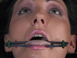 Hot brunette whore Wenona has her tongue, hand and legs spread and tied up on the bed. Then, a man called Matt comes and sticks his big cock in that wet cunt of hers. He starts fucking her so hard and they are both moaning with so much pleasure. She is such a hot slut and that makes Matt very horny.
