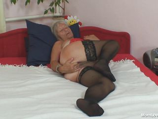 Horny granny Cecilie is ready to get some fun. This blonde bitch is naked on her bed and fingering her pussy with all of her fingers and rubbing her clitoris to make it wet. After that this whore takes a big dildo and she inserts it deep in her vagina.