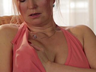 Look at this sexy milf, Thekla M with her round boobs and hard nipples on them. Here this blonde bitch is crushing her boobs like hell. and right after that she is rubbing her pussy to make it wet. Then she is taking her clothes off and making her hands running on her huge boobs again and again.
