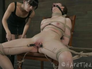 Tied hard on that chair and with a device that keeps her mouth opened wide Alani gets mouth fucked with a dildo by her mistress before her treatment continues. Alani's pink fragile pussy is tortured as metal clamps on her pussy lips keeps that cunt gaped. Look at it, so wet and tight, it will be a shame to ignore it