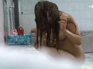 It's a public shower and someone has a camera partially hidden behind a towel. Two sexy Asian honeys are washing their hair and their bodies down, talking to each other and laughing, unknown to them their every move is on tape for all of us to see! Will they do something dirty as they get clean?