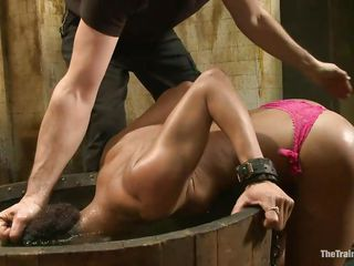 She's pretty hot, that naughty fit ass, sexy legs and cock asking mouth says it all about her and because this whore was such a bad girl her executor decided to give her one hell of a punishment. After putting her head under water several time he tied her, cut her panties and stuffed her mouth with them, what's next?