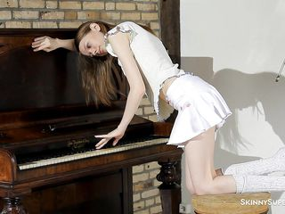 Maybe she knows how to play at the piano or maybe she doesn't but surely she's a beauty and really knows how to make our cock hard. Watch her how she misbehaves and starts being a slut, undressing and when she's only in her panties, Gloria pulls them and squeezes her cunt. Hmm, this cutie has some talents, no doubt!