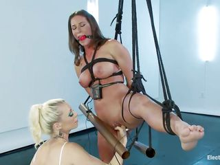 Trashy slut Ariel is all tied up by horny milf Lorelei. She stays with one leg in the air to reveal her tight pussy, having it punished harshly. The bitch wants more, as Lorelei drives her crazy with fingering, switching to pussy fisting and electric vibrator on her pink clitoris. Watch them fulfilling their deepest desires with a magic wand!