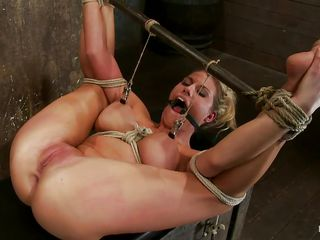 If you like to watch a blonde slut tied up fingered and punished then this is surely for you. Her name is Charisma Cappelli, a chick with big sexy breasts, hot thighs and a shaved pink pussy between them that her executor is rubbing with a vibrator and fingers it hard. She screams with pleasure and pain but her screaming doesn't impress nobody and the punishment continues.