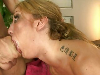 After a throating session, Amy Brooke is coated