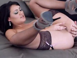 Curvy and elegant girl in stockings masturbates